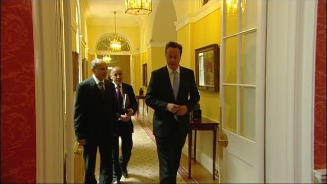 Interior shots Prime Minister David Cameron walks inside Number 10 Downing Street with Libyan Rebel leader Mustafa Abdul Jalil both pose for photo...