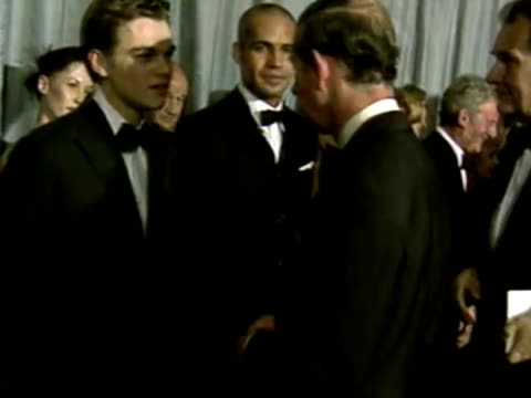 interior shots prince charles meeting cast and crew from titanic movie including leonardo di caprio and billy zane. titanic premiere - interiors on... - film premiere stock videos & royalty-free footage