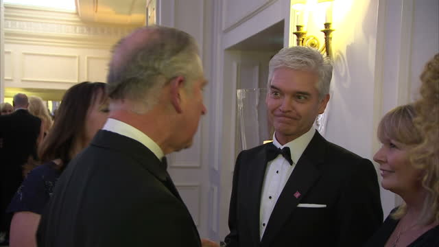 interior shots prince charles, prince of wales meeting and talking with philip schofield at prince's trust charity event. on in london, england. - phillip schofield stock videos & royalty-free footage