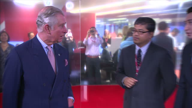 Interior shots Prince Charles Prince of Wales on visit to BBC New Broadcasting House being shown a BBC News TV Studio and talks with staff on in...
