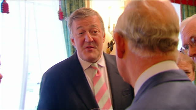 interior shots prince charles prince of wales talking with actor stephen fry at reception prince charles hosts a reception for the samaritans charity... - stephen fry stock videos & royalty-free footage