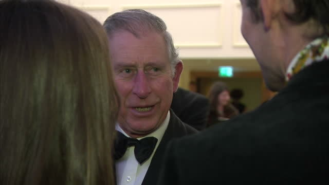 Interior shots Prince Charles Prince of Wales talking with guests at Prince's Trust charity event at the Savoy Hotel on in London England