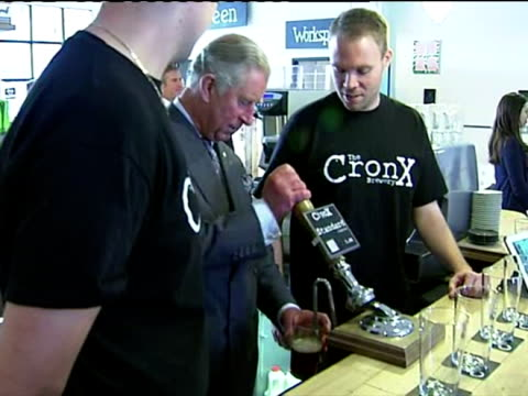 vídeos de stock e filmes b-roll de interior shots prince charles pulls a pint of beer & samples it during a visit to matthew's yard in croydon as part of a visit to see progress since... - croydon inglaterra