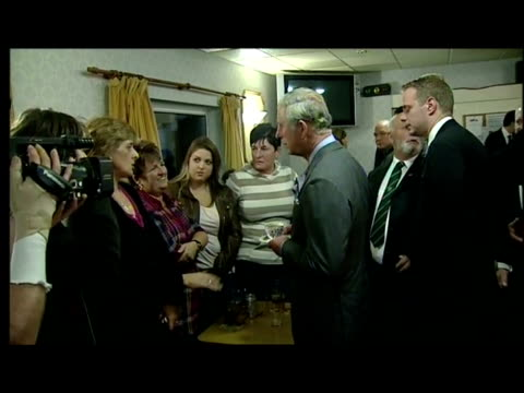 interior shots prince charles visiting victims of the recent floods in cornwall. prince charles in cornwall after flooding on november 19, 2010 in... - 1 minute or greater stock videos & royalty-free footage
