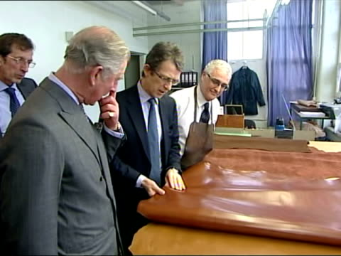 interior shots prince ckharles being shown shoe making process, chatting to craftsman. hrh the prince of wales visits crockett & jones factory in... - northampton england stock videos & royalty-free footage