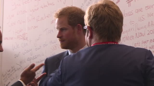durban interior shots prince harry and elton john hugging charity spokesperson ahead of photocall - elton john stock videos & royalty-free footage