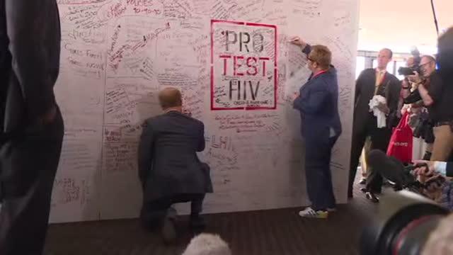 interior shots prince harry and elton john signing pro test hiv wall during photo call. - elton john stock videos & royalty-free footage