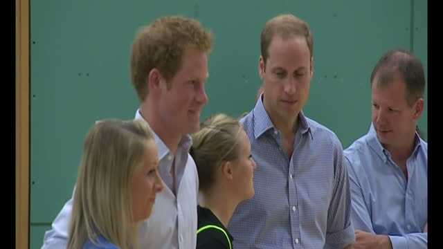 interior shots Prince Harry and William Duke of Cambridge enter sports hall and watch Coach Core training session talking to workers