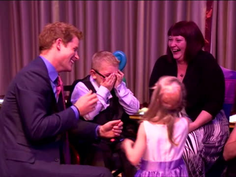 interior shots prince harry chats with a group of small children as a little girl licks his face which makes him laugh prince harry's first... - laughing stock videos & royalty-free footage