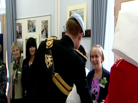 interior shots prince harry dressed in the uniform of the blues & royals meets staff, dignitaries & residents in the margaret thatcher infirmary at... - 40 seconds or greater stock videos & royalty-free footage