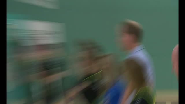 interior shots Prince Harry playing in indoor football match with William watching on from sidelines