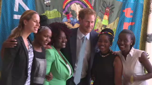 interior shots prince harry posing for cameras with a group of young ambassadors. - photo call stock videos & royalty-free footage