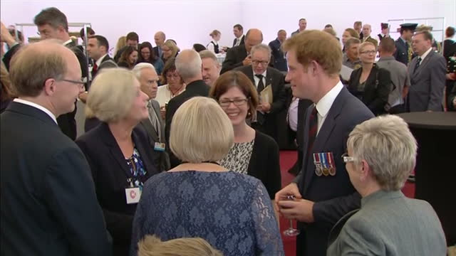 interior shots prince harry talking to guests at wwi commemorative event on august 04, 2014 in mons, belgium. - 一百週年紀念 個影片檔及 b 捲影像