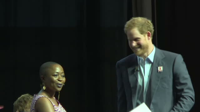 durban interior shots prince harry walks to podium and gives speech speaks on children effected by aids - durban stock videos & royalty-free footage