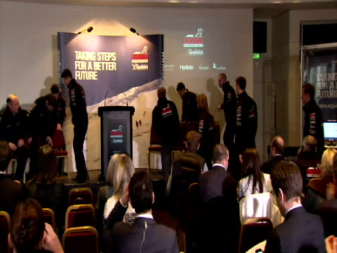 Interior shots Prince Harry walks with fellow members of Walking with the Wounded Charity into press conference Prince Harry Walking with Wounded...