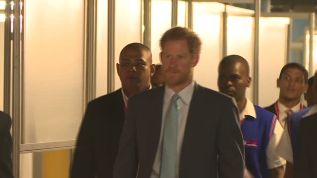 durban interior shots prince harry with entourage walks into conference centre - hiv aids conference stock videos & royalty-free footage