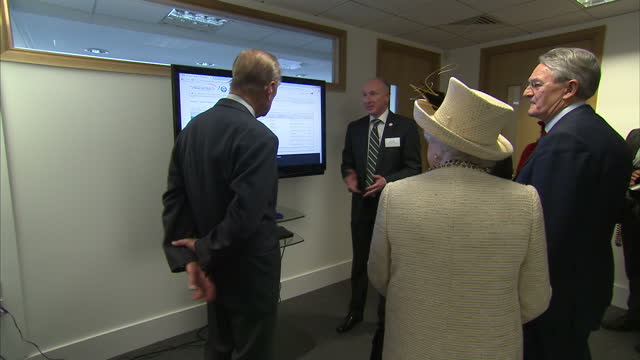 Interior shots Prince Philip the Queen talking to employees at the RSC on March 12 2014 in London England
