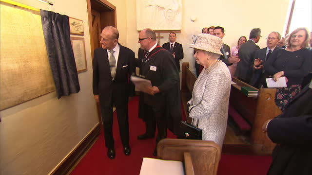 Interior shots Prince Philip unveiling plaque drawing back curtains to applause on March 06 2014 in Cobham England