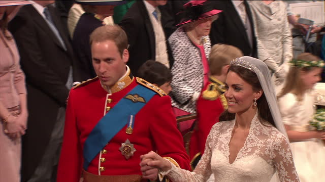 Interior shots Prince William and Catherine Middleton holding hands smiling and looking very happy followed by Prince Harry and Pippa Middleton walk...