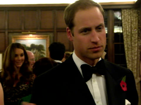 Interior shots Prince William Catherine Duchess of Cambridge chat mingle with guests at a St Andrews University fundraising event William Kate Attend...