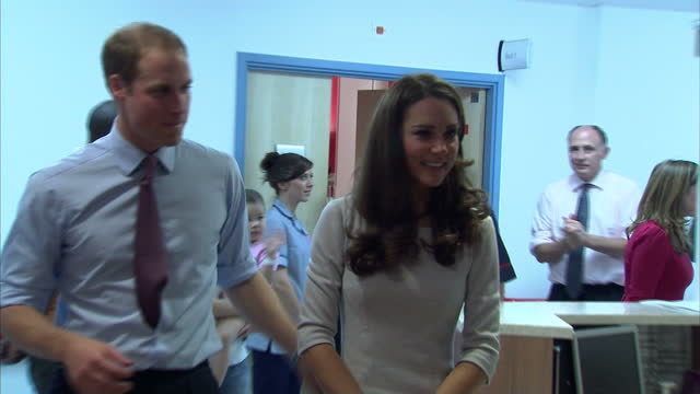 Interior shots Prince William Catherine Duchess of Cambridge walk into the Oak Centre Unit at the Royal Marsden hospital sit down chat with cancer...