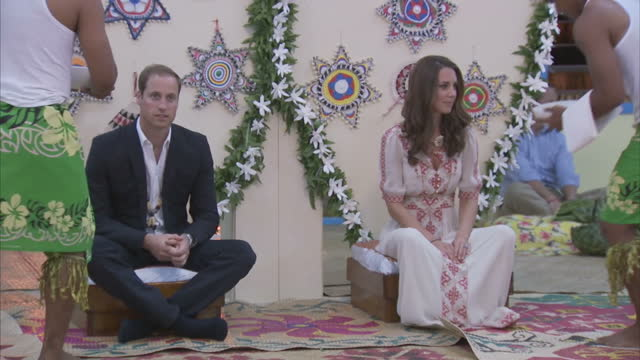 interior shots prince william catherine duchess of cambridge who wears a dress by angela temperley sit on low stools for a banquet exterior shots... - royal tour stock videos & royalty-free footage
