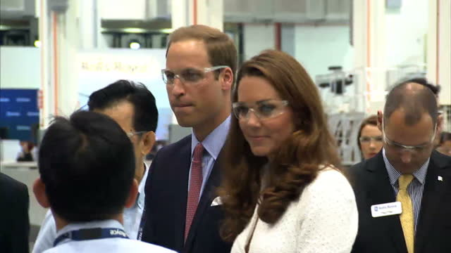 stockvideo's en b-roll-footage met interior shots prince william catherine duchess of cambridge who wears alexander mcqueen broderie anglaise suit tour rolls royce factory with... - rolls royce