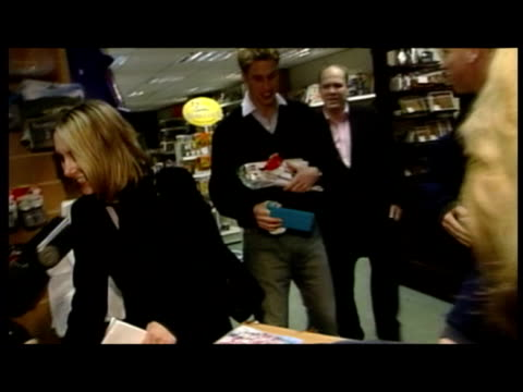 interior shots prince william choosing sweets and paying for goods during his time as a student at st andrews university. prince william student days... - st. andrews scotland stock videos & royalty-free footage