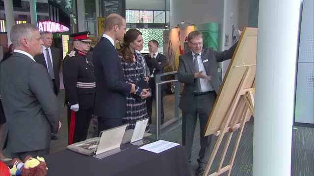 interior shots prince william duke of cambridge and catherine duchess of cambridge visiting national football museum on october 14 2016 in manchester... - 公爵点の映像素材/bロール