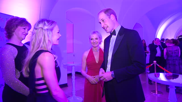 Interior shots Prince William Duke of Cambridge at the Child Bereavement UK 21st Birthday Dinner talking with guests on October 15 2015 in London...