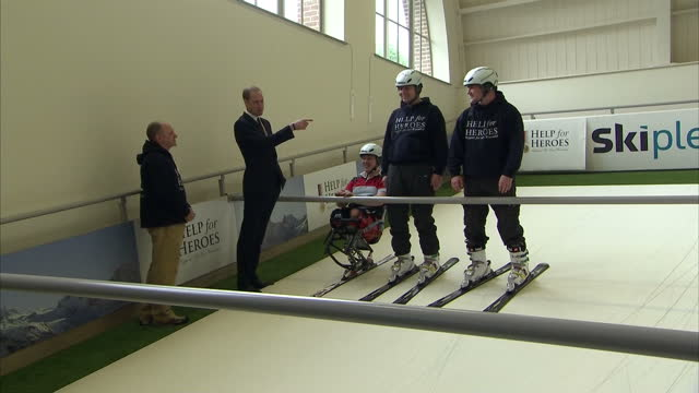 interior shots prince william, duke of cambridge, watches & talks to injured service personnel skiing on an indoor ski slope simulator during his... - tidworth stock videos & royalty-free footage