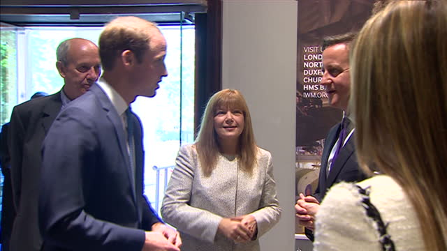 stockvideo's en b-roll-footage met interior shots prince william meeting shaking hands with david cameron lord rothermere at the imperial war museum on july 17 2014 in london england - imperial war museum museum