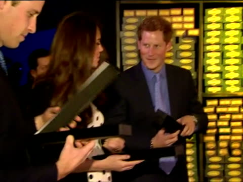 Interior shots Prince William Prince Harry and Catherine Duchess of Cambridge presented with Harry Potter wands The Duke and Duchess of Cambridge and...
