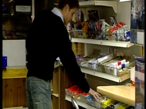 interior shots prince william shopping in newsagents during his student days at st andrews university. prince william student days - at the... - st. andrews scotland stock videos & royalty-free footage