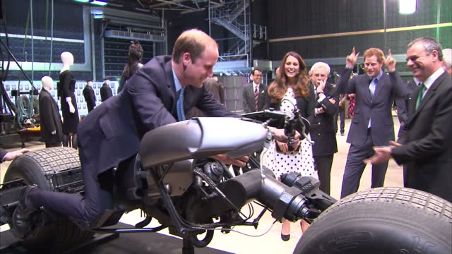 interior shots prince william sits on batman bike the duke and duchess of cambridge and prince harry attend the inauguration of warner bros. studios... - warner bros stock videos & royalty-free footage