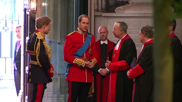 interior shots prince william wearing the uniform of colonel of the irish guards & prince harry in full uniform of the blues & royals chat with... - clergy stock videos & royalty-free footage
