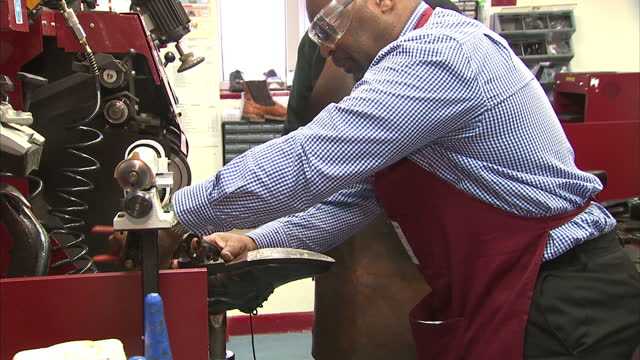 interior shots prisoner learning to resole shoes in timpson's workshop high street businesses are being encouraged to hire more prisoners both... - prisoner uk stock videos & royalty-free footage