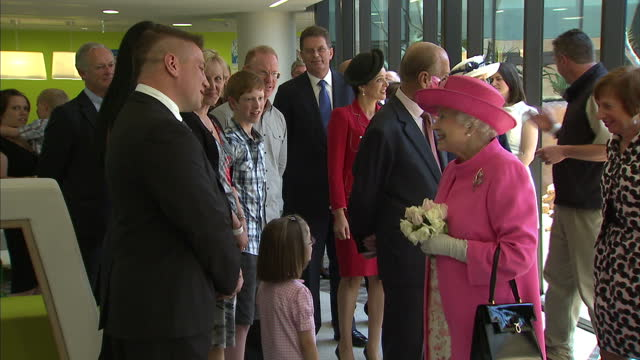 interior shots queen accompanied by prince philip duke of edinburgh officially opens melbourne royal children's hospital and accepts flowers from... - 退院点の映像素材/bロール