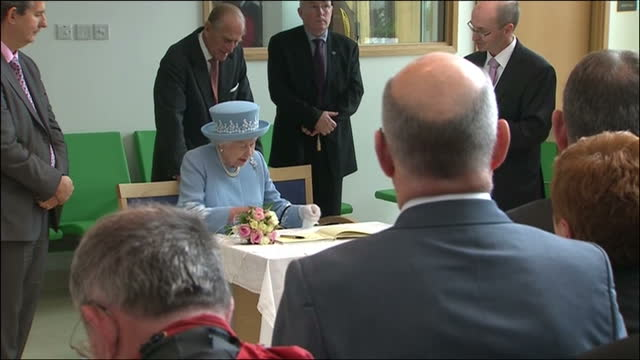 interior shots queen and prince philip duke of edinburgh sign visitors' book at enniskillen hospital queen elizabeth ii diamond jubilee coverage on... - signierstunde stock-videos und b-roll-filmmaterial