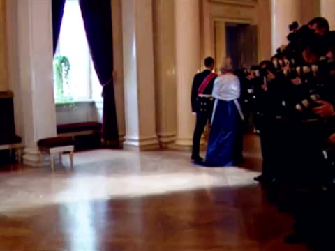 interior shots queen arrive at state banquet w/ king harald followed by price philip queen then prince regent and wife to beinterior shots queen king... - king royal person stock videos & royalty-free footage