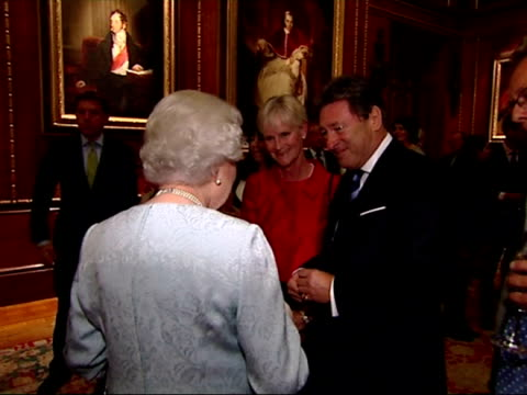 interior shots queen chatting to alan titchmarsh at reception for the participants of the royal windsor horse show jubilee pageant. queen and philip... - alan titchmarsh stock videos & royalty-free footage