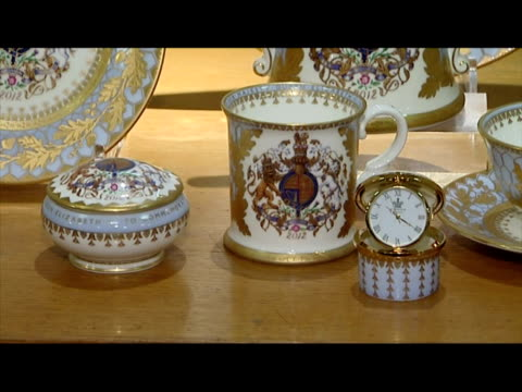 interior shots queen diamond jubilee royal china set including decorative plates bowls mug cups saucer queen's diamond jubilee china set on display... - saucer stock videos & royalty-free footage