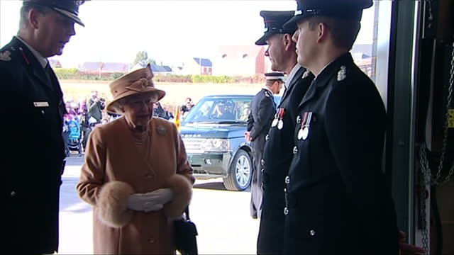 interior shots queen elizabeth ii shaking hands with fire fighters in dress uniform - dress stock videos & royalty-free footage