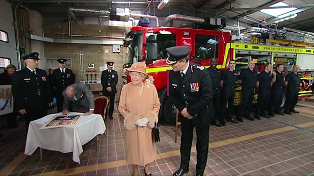 interior shots queen elizabeth ii signing portrait photo at table followed by prince philip - elizabeth i of england stock videos & royalty-free footage