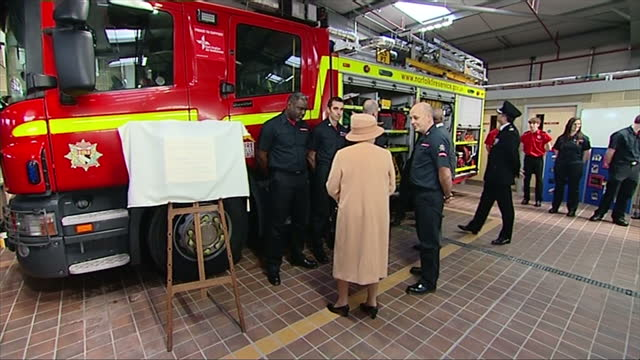 interior shots queen elizabeth shaking hands and speaking with fire fighter fire engine in background - elizabeth i of england stock videos & royalty-free footage