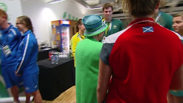 interior shots queen elizabeth speaking to english and scottish international swimmers - commonwealth games stock videos & royalty-free footage