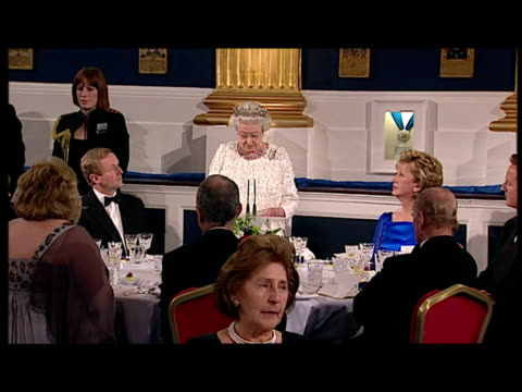 interior shots queen elizabeth stands addresses a formal state audience in a speech at dublin castle in an unprecedented address to dignitaries at... - the queen stock videos and b-roll footage