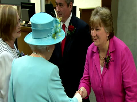 interior shots queen elizabeth walks down corridor followed by aides greets scottish first minister alex salmond other scottish parliament officials... - other stock videos & royalty-free footage