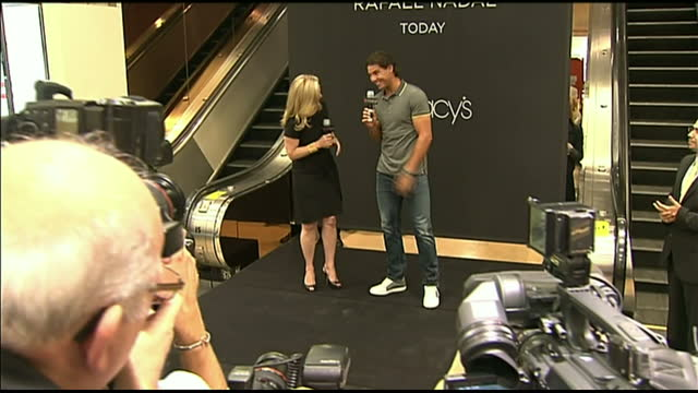 Interior shots Rafael Nadal unveils new billboard for Armani jeans in Macy's department store poses for the press Rafael Nadal at Macy's Department...