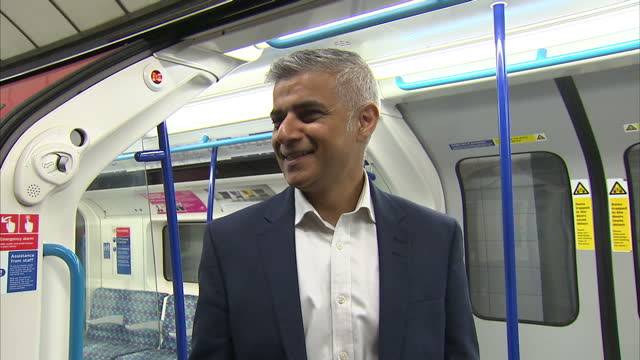 interior shots sadiq khan london mayor posing for photographs on london underground train on first night of the 24 hour night tube service on august... - sadiq khan stock videos & royalty-free footage